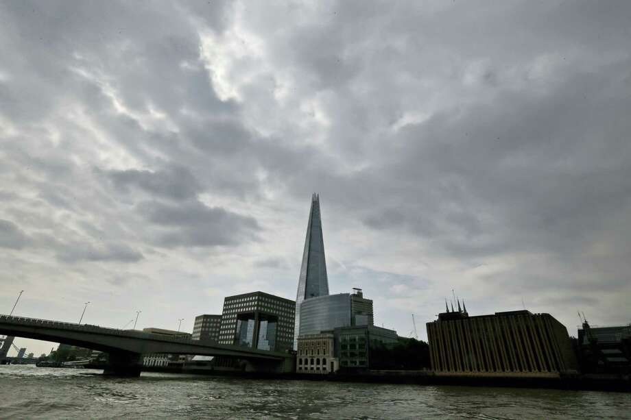 """In this Thursday, June 19, 2014, file photo, the Shard as seen from the river Thames in London. A new report says a drone just missed hitting an A320 passenger plane flying above the Shard skyscraper in central London in July. The """"very near-miss"""" underscored the fears of many aviation experts about the growing popularity of drones. The plane was approaching Heathrow Airport and flying at nearly 5,000 feet (1,525 meters) when the pilot spotted a 50-centimeter (20-inch) drone off the right flight deck window, it was reported on Thursday, Nov. 17, 2016. Photo: AP Photo/Lefteris Pitarakis, File    / Copyright 2016 The Associated Press. All rights reserved."""