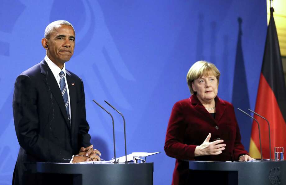 U.S. President Barack Obama, left, and German Chancellor Angela Merkel attend a press conference after a meeting in the chancellery in Berlin, Germany, Thursday. Germany is the last European stop of Obama's final tour abroad as U.S. president. Photo: The Associated Press   / Copyright 2016 The Associated Press. All rights reserved.