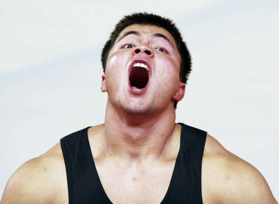 In this Sept. 25, 2010, file photo, Kazakhstan's Vladimir Sedov competes in the Men's 94-kilogram category at the World Weightlifting Championships in Antalya, Turkey. Kazakhstan said there are retrospective disqualifications from the 2008 games for weightlifters Sedov and Maiya Maneza, while another weightlifter, Almas Uteshov, has been scratched from the 2012 Olympics. Photo: AP Photo/Burhan Ozbilici, File    / Copyright 2016 The Associated Press. All rights reserved.