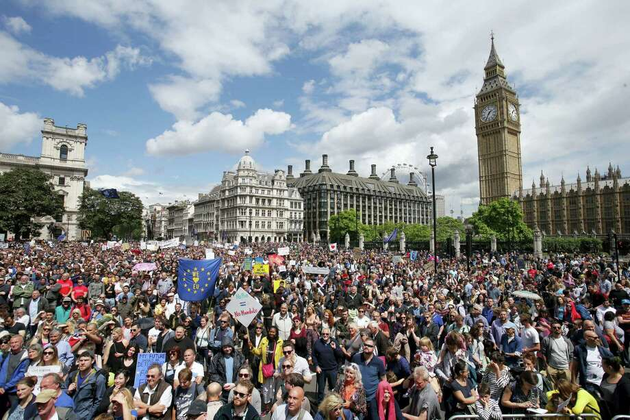 """""""Remain"""" supporters demonstrate in Parliament Square, London, to show their support for the European Union in the wake of the referendum decision for Britain to leave the EU, known as """"Brexit"""" onJuly 2, 2016. Demonstrators wearing EU flags as capes and with homemade banners saying """"Bremain"""" and """"We Love EU"""" gathered on the streets for the March for Europe rally. At rear right is the Elizabeth Tower containing Big Ben. Photo: Daniel Leal-Olivas/PA Via AP   / PA"""