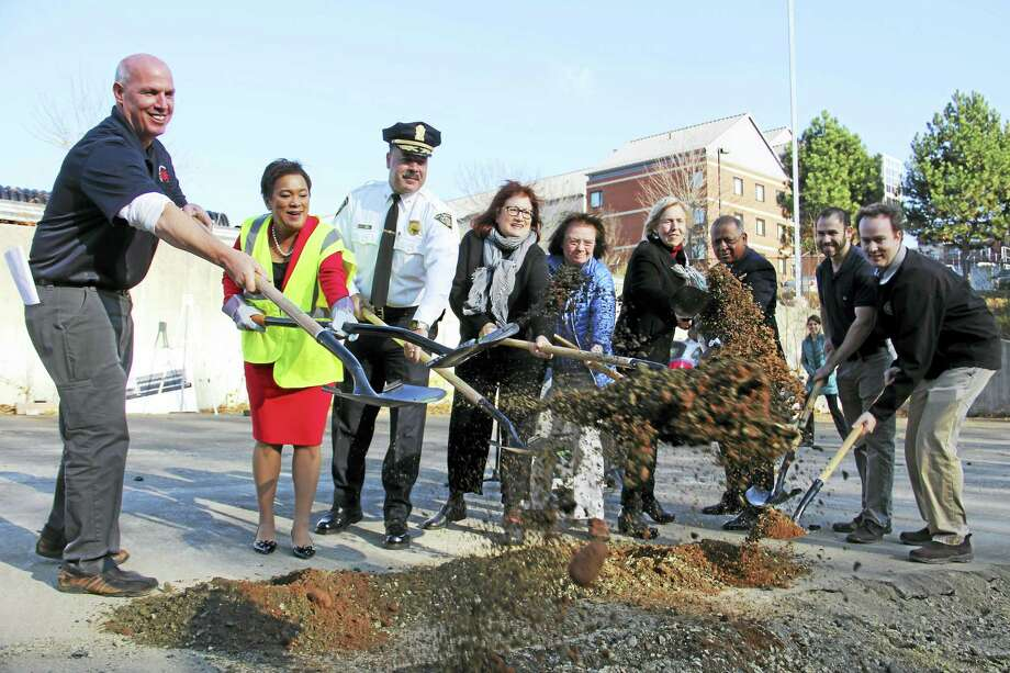 New Haven city and police officials join community members in celebrating the ground-breaking of the police department's new firing range Thursday in New Haven. Photo: Esteban L. Hernandez — New Haven Register