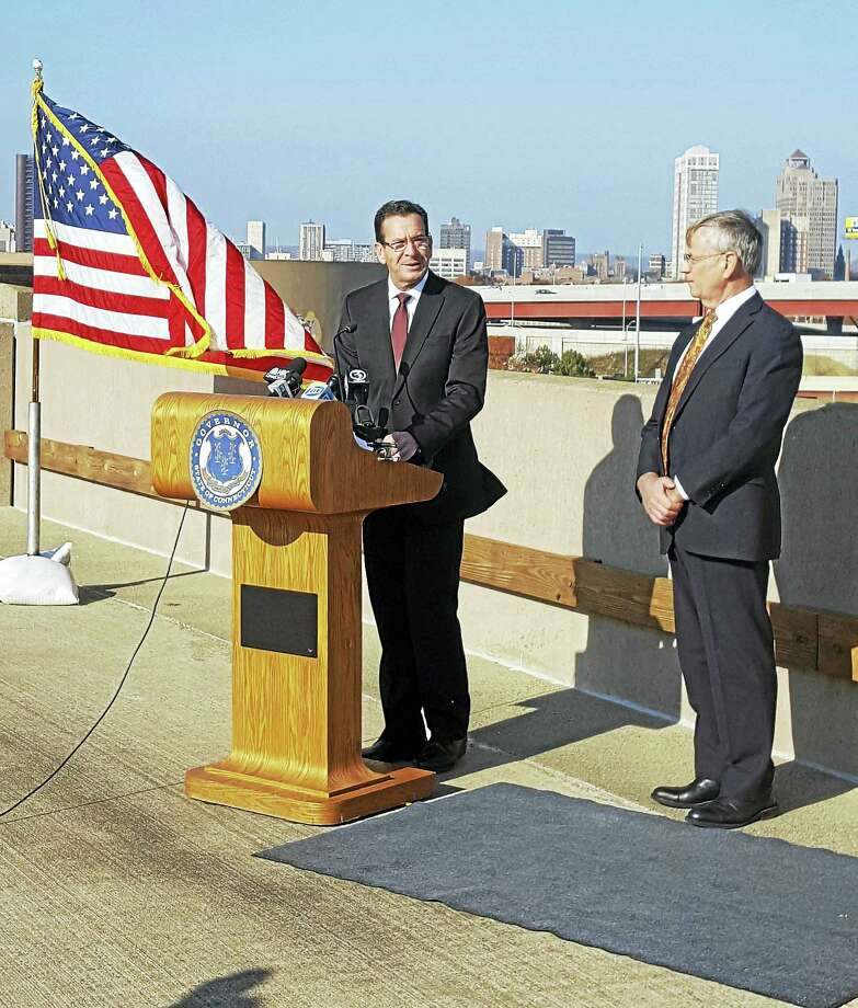 Gov. Dannel Malloy and Department of Transportation Commissioner James Redeker speak about the substantial completion of the New Haven Harbor Crossing project in New Haven. Photo: Contributed Photo