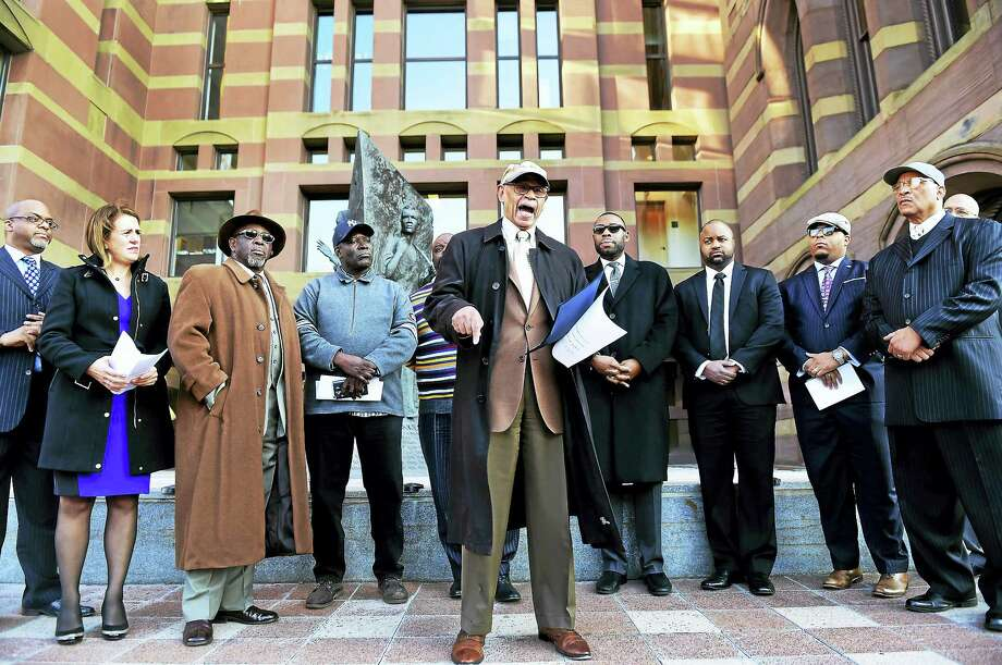 Bishop Theodore Brooks, of Beulah Heights First Pentecostal Church in New Haven, center, speaks during a press conference at the Amistad Memorial at New Haven City Hall Thursday with other faith leaders calling on state legislators to adopt a fair education funding formula. Photo: Peter Hvizdak — New Haven Register   / ?2016 Peter Hvizdak