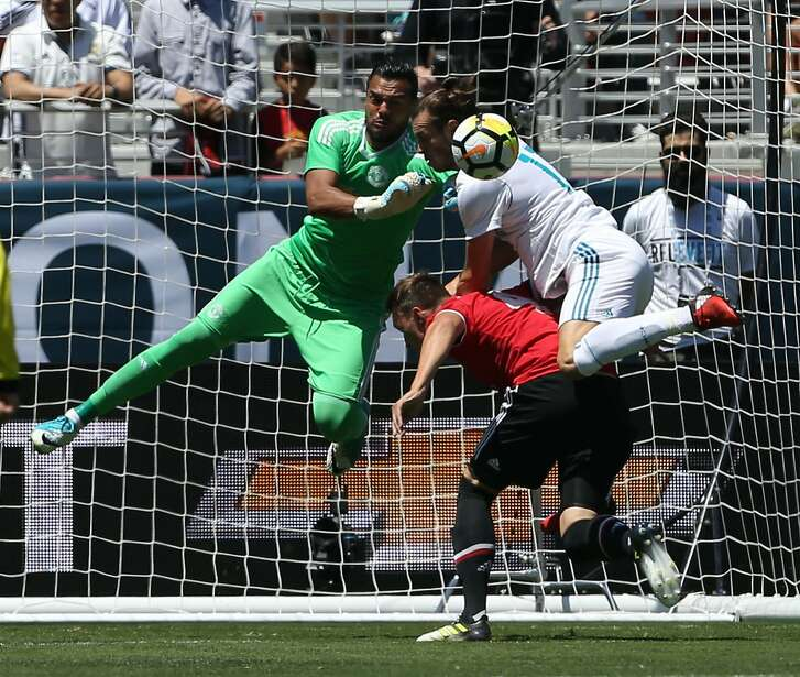 Manchester United goal keeper Sergio Romero (left) attempts to block a shot while defender Phil Jones and Real Madrid forward Gareth Bale (right) collide during the first half of the International Champions Cup match on July 23, 2017 in Santa Clara, California.  / AFP PHOTO / Beck DiefenbachBECK DIEFENBACH/AFP/Getty Images