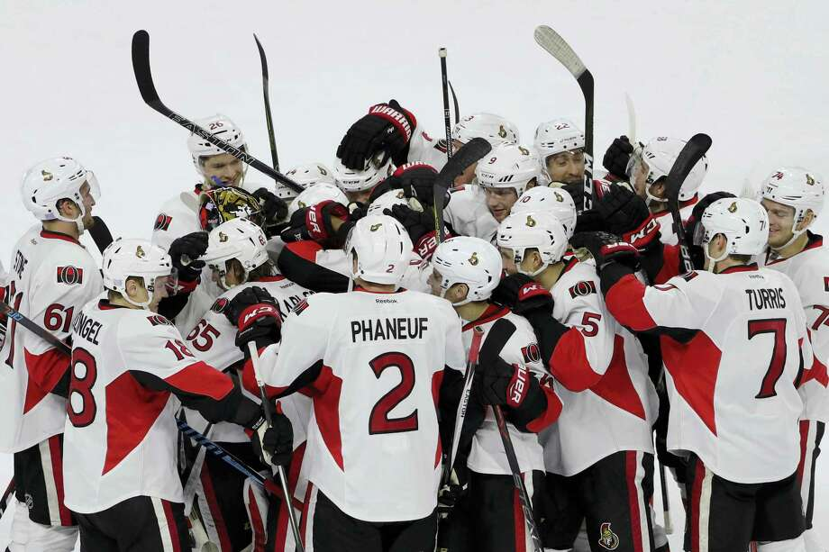 Ottawa Senators' players celebrate with Erik Karlsson (65) after he scored the game-winning goal during a shootout in an NHL hockey game against the Philadelphia Flyers Tuesday, Nov. 15, 2016 in Philadelphia. Ottawa won 3-2. Photo: AP Photo/Matt Slocum   / AP