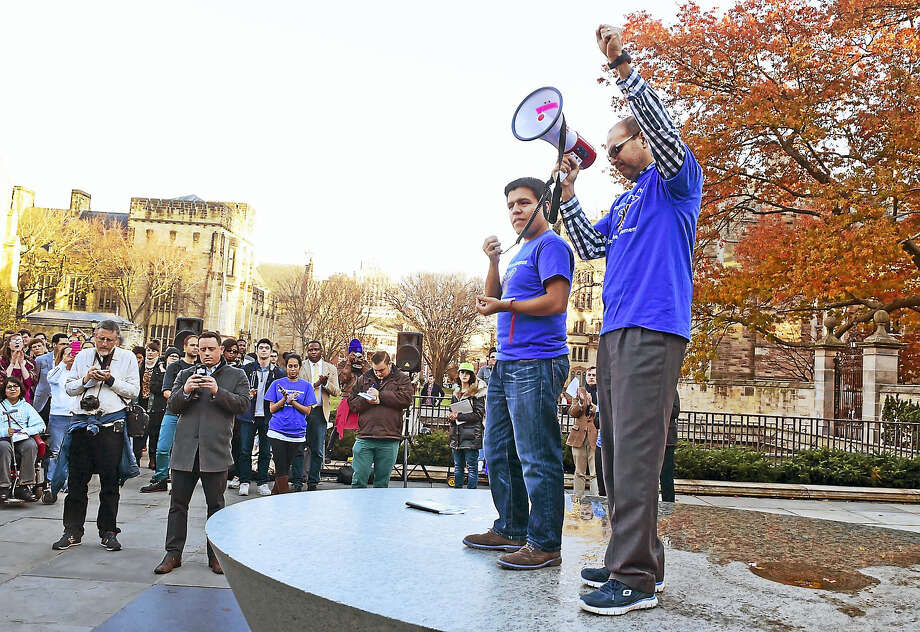 "Ramon Garibaldo Valdez, a Yale graduate student in political science who is an  undocumented immigrant, left, with Dax Crocker, a third-year Yale Master of Divinity student, right, call on all Yale University students to join together and declare Yale a ""Sanctuary Campus"" during a rally Wednesday at Cross Campus in New Haven. Photo: Peter Hvizdak — New Haven Register   / ©2016 Peter Hvizdak"
