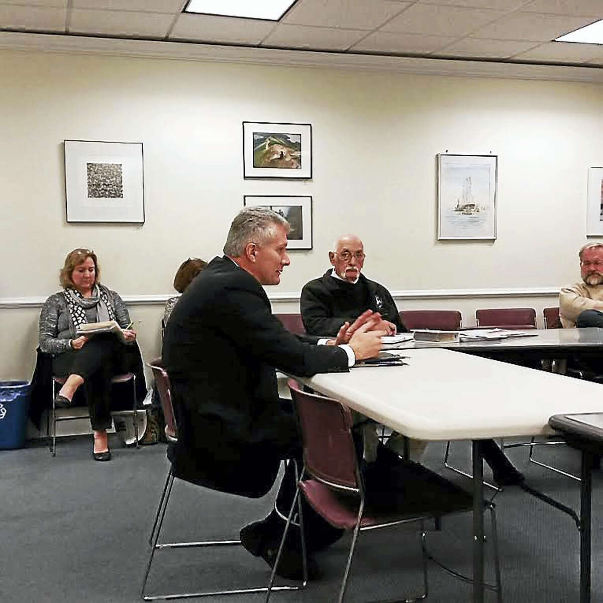 Quinnipiac University Facilities Director Sal Filardi discusses the six historic properties the university owns and plans to demolish with the Historic Properties Commission Wednesday.