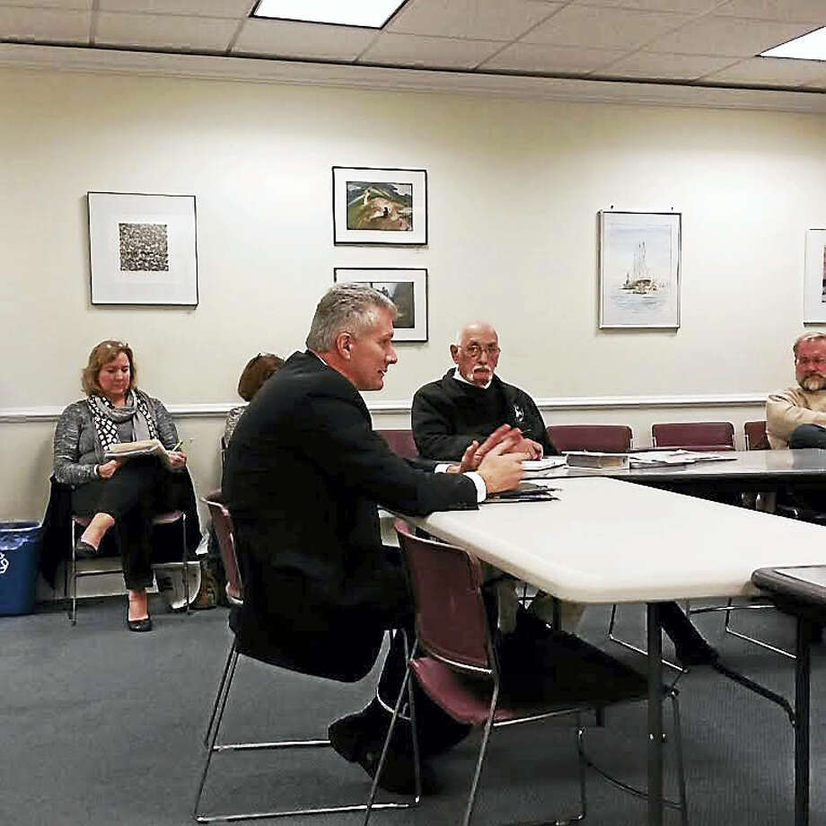 Quinnipiac University Facilities Director Sal Filardi discusses the six historic properties the university owns and plans to demolish with the Historic Properties Commission Wednesday. Photo: Kate Ramunni — New Haven Register