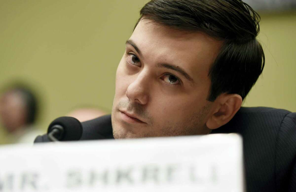 In this Feb. 4, 2016 photo, former Turing Pharmaceuticals CEO Martin Shkreli attends the House Committee on Oversight and Reform Committee hearing on Capitol Hill in Washington. In 2015, Shkreli reneged on a pledge to lower the price of the life-saving anti-infection drug Daraprim after raising it 5,000 percent.