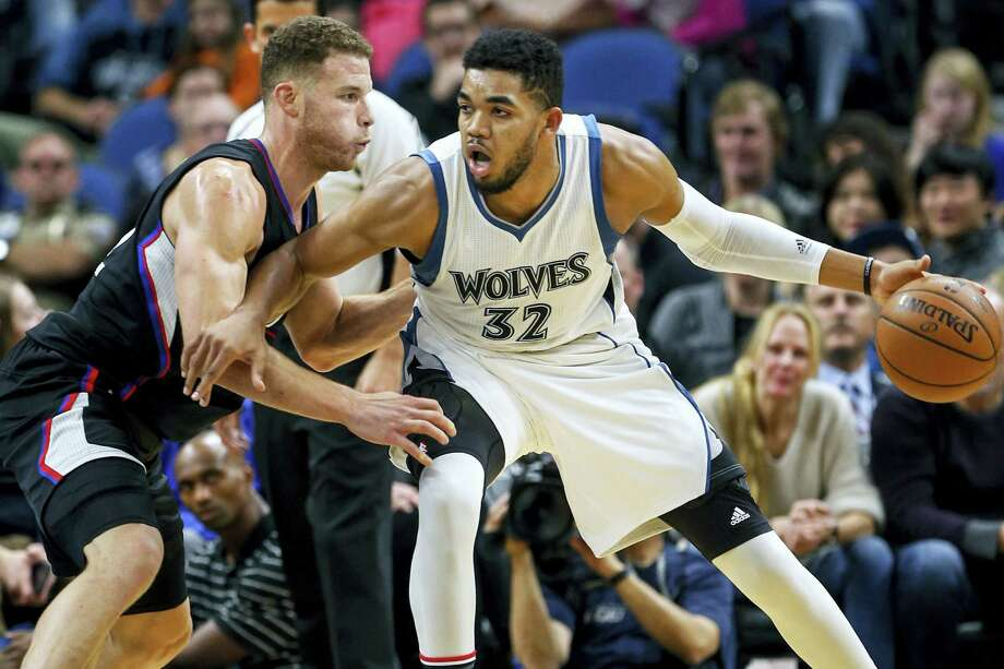 Los Angeles Clippers forward Blake Griffin (32) defends Minnesota Timberwolves center Karl-Anthony Towns (32) in the second half of an NBA basketball game on Nov. 12, 2016 in Minneapolis. The Clippers won 119-105. Photo: AP Photo/Bruce Kluckhohn   / Associated Press