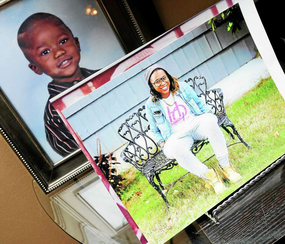 A photo of Erika Robinson is displayed in the living room of her parents' home in West Haven in 2014. Photo: Arnold Gold — New Haven Register