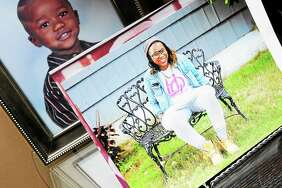 A photo of Erika Robinson is displayed in the living room of her parents' home in West Haven in 2014.