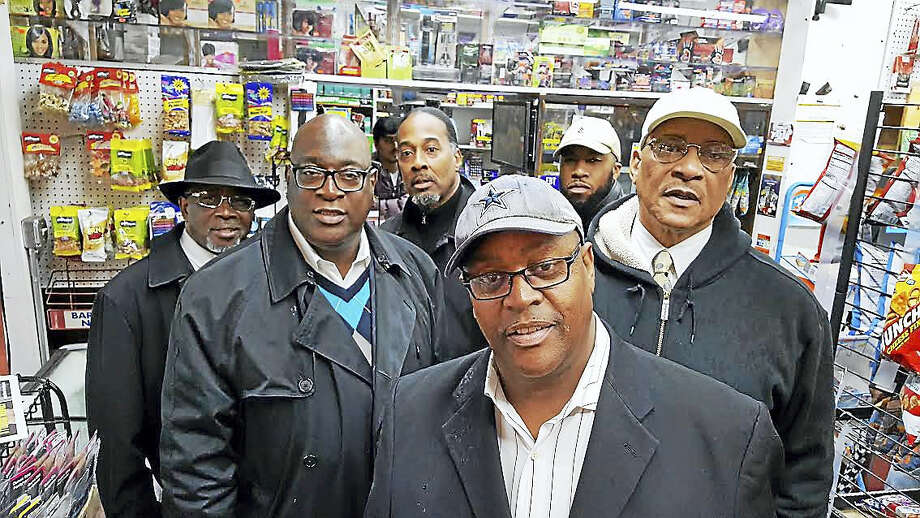 Members of the Greater New Haven Clergy Association hold a press conference Tuesday at Dix Deli on Dixwell Avenue in New Haven. Photo: SHAHID ABDUL-KARIM — NEW HAVEN REGISTER