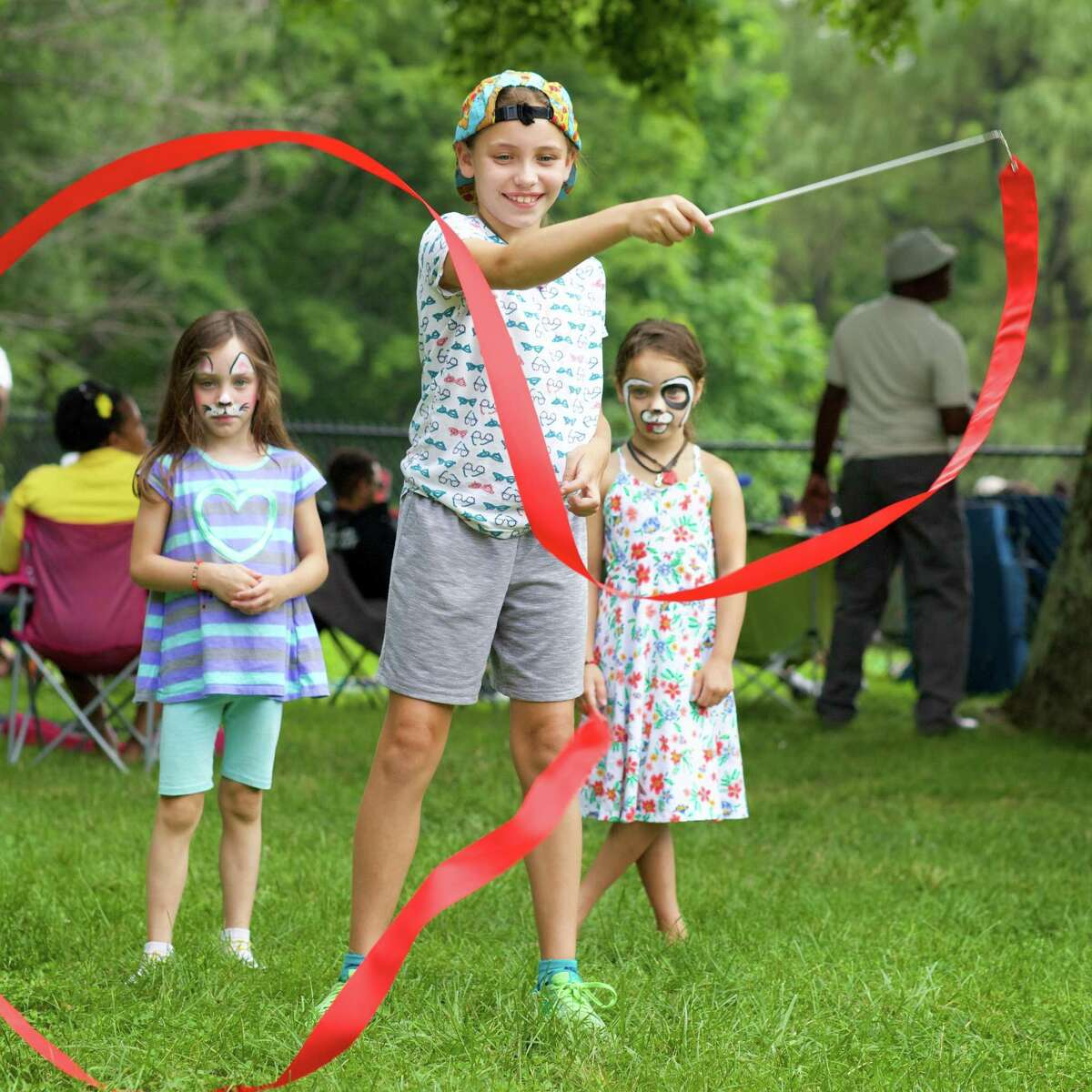 Enjoying some ribbon dancing are sisters (left to right) Ripley Frantons (age 5), Olivia Franson (age 10) and Rowan Franson (age 5) all from Newtown at the Sixth Annual Westside Reggae Festival that took place on Sunday, July 23rd, 2017, at Ives Concert Park in Danbury, CT.