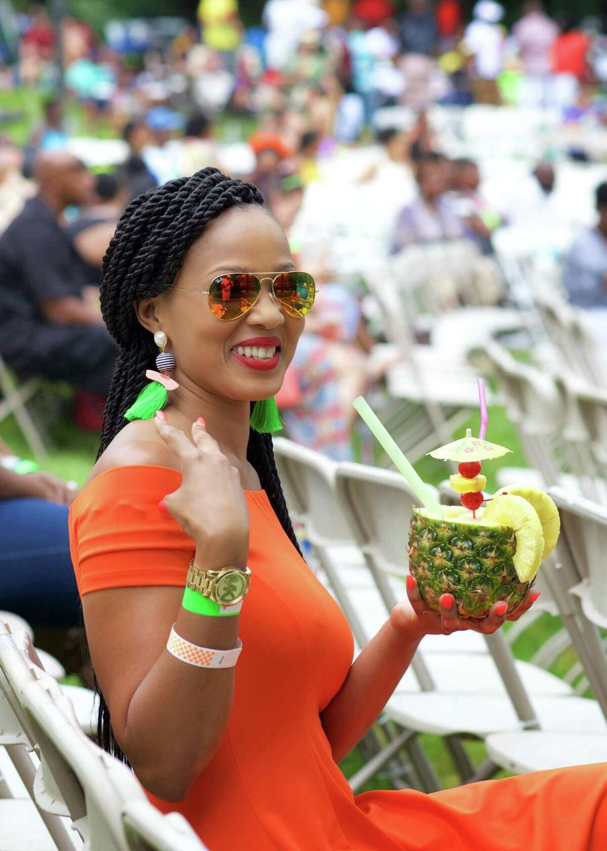 Enjoying the music and a delicious Pina Colada is Darcia Prince from Queens, NY, during the Sixth Annual Westside Reggae Festival that took place on Sunday, July 23rd, 2017, at Ives Concert Park in Danbury, CT.