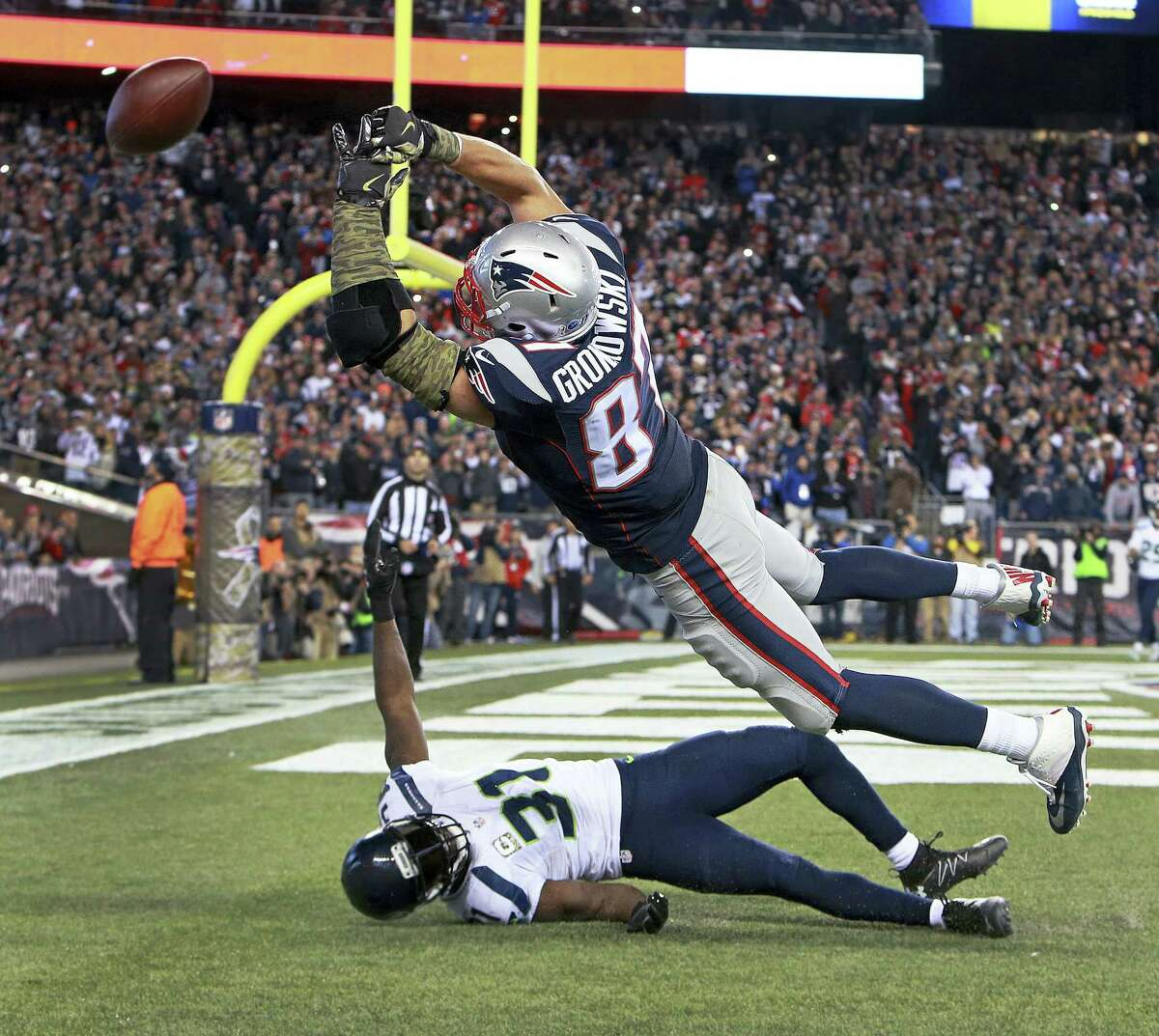 New England Patriots tight end Rob Gronkowski (87) can't catch a pass in the end zone over Seattle Seahawks safety Kam Chancellor (31) at the end of an NFL football game on Sunday, Nov. 13, 2016 in Foxborough, Mass.