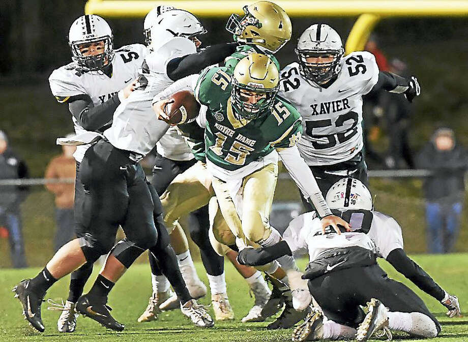 Notre Dame quarterback Christopher Elias breaks through the Xavier defense in 20-0 win for the Green Knights this weekend at Veterans Stadium in West Haven. Photo: Catherine Avalone — New Haven Register