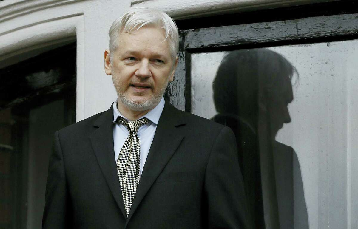 In this Feb. 5, 2016 photo, WikiLeaks founder Julian Assange speaks from the balcony of the Ecuadorean Embassy in London. Assange will be interviewed about Swedish sex crime allegations at the Ecuadorean Embassy in London on Monday, Nov. 14, 2016.