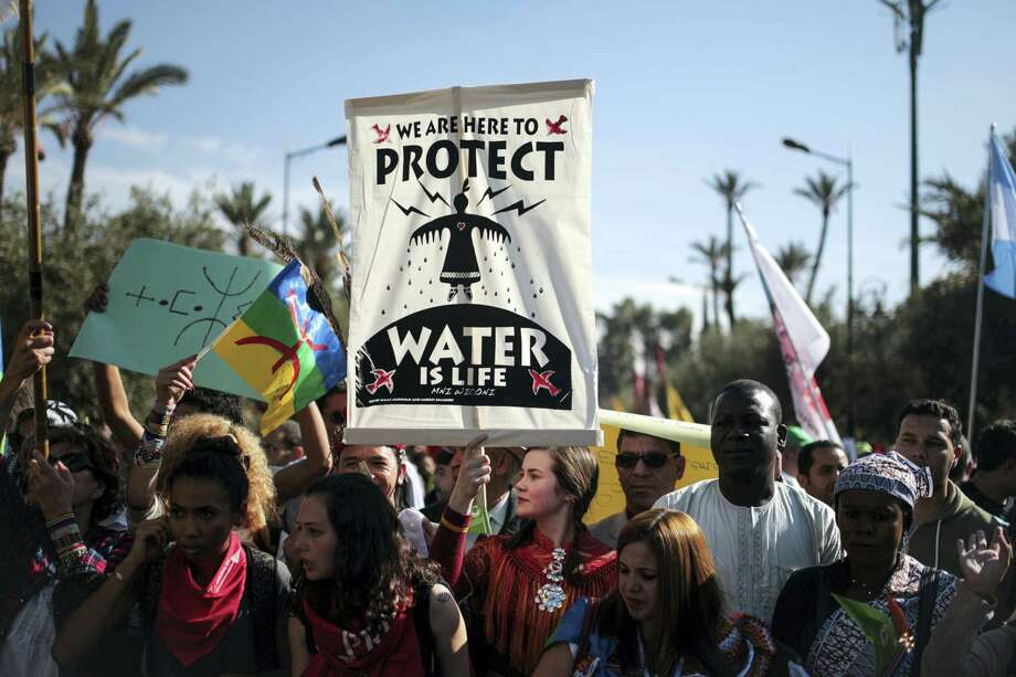 Hundreds protest against climate change and urge world leaders to take action, in a march coinciding with the Climate Conference, known as COP22, taking place in Marrakech, Morocco on Nov. 13, 2016. Photo: AP Photo/Mosa'ab Elshamy   / Copyright 2016 The Associated Press. All rights reserved.