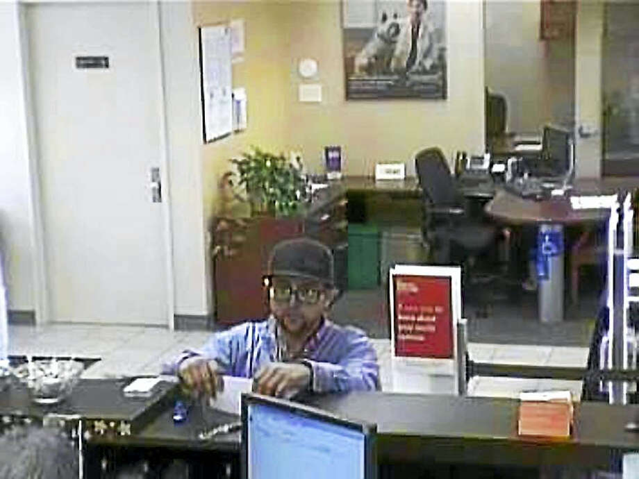North Haven police are asking the public to help them find this man who allegedly robbed Wells Fargo Bank, 80 Washington Ave., early Monday afternoon. No one was hurt in the robbery. Photo: Photo Courtesy Of The North Haven Police Department