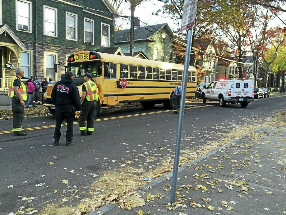 Five children were taken to the hospital and part of Orchard Street in New Haven was shut down Monday after a car crashed into a school bus just south of Elm Street. Photo: Wes Duplantier — New Haven Register