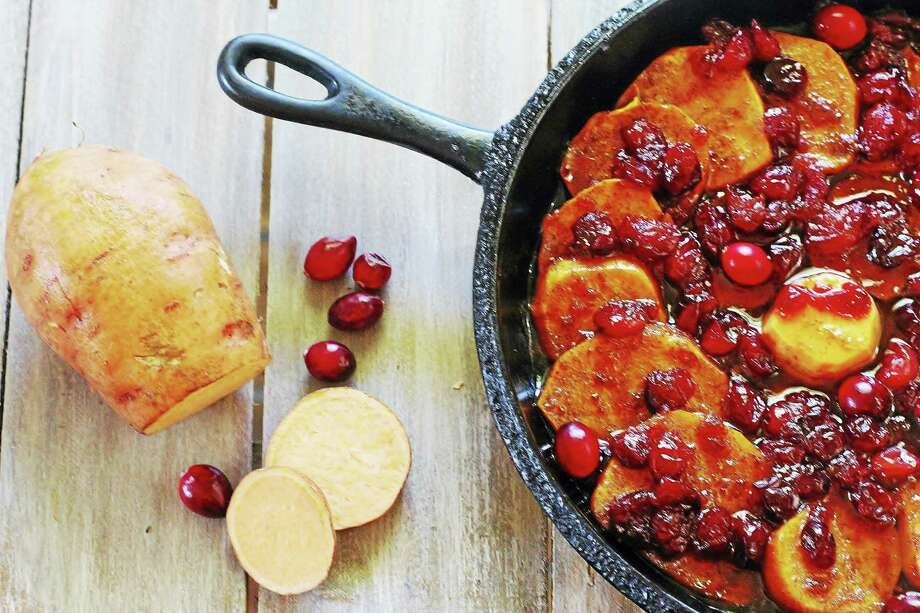 Try cranberry glazed sweet potatoes as a Thanksgiving side dish this year. Photo: Photo Courtesy Of Jackie Garvin — Skyhorse Publishing   / Jackie Garvin    {@2011}