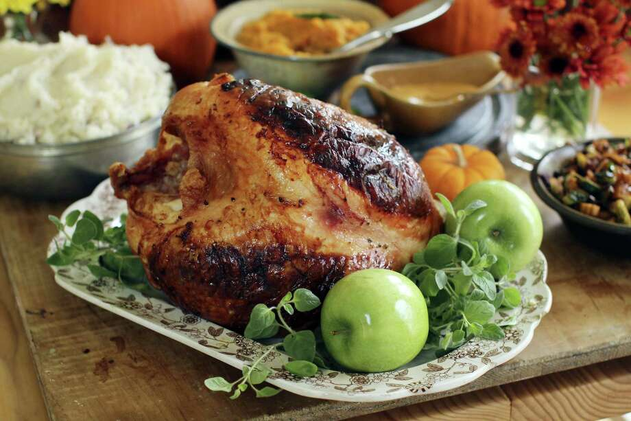 If you're not feeding a crowd for the holidays, then an Italian-style roast turkey breast could be the way to go. Photo: Matthew Mead — The Associated Press   / FR170582 AP