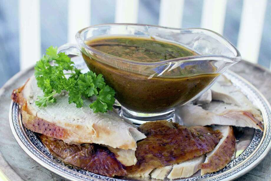 The turkey stock used in this gravy recipe takes a few hours to make, but it is mostly hands off. The gravy itself also can be prepped ahead up to the point of needing the roasted turkey drippings, then quickly finished just before serving. Photo: Matthew Mead — The Associated Press   / FR170582 AP