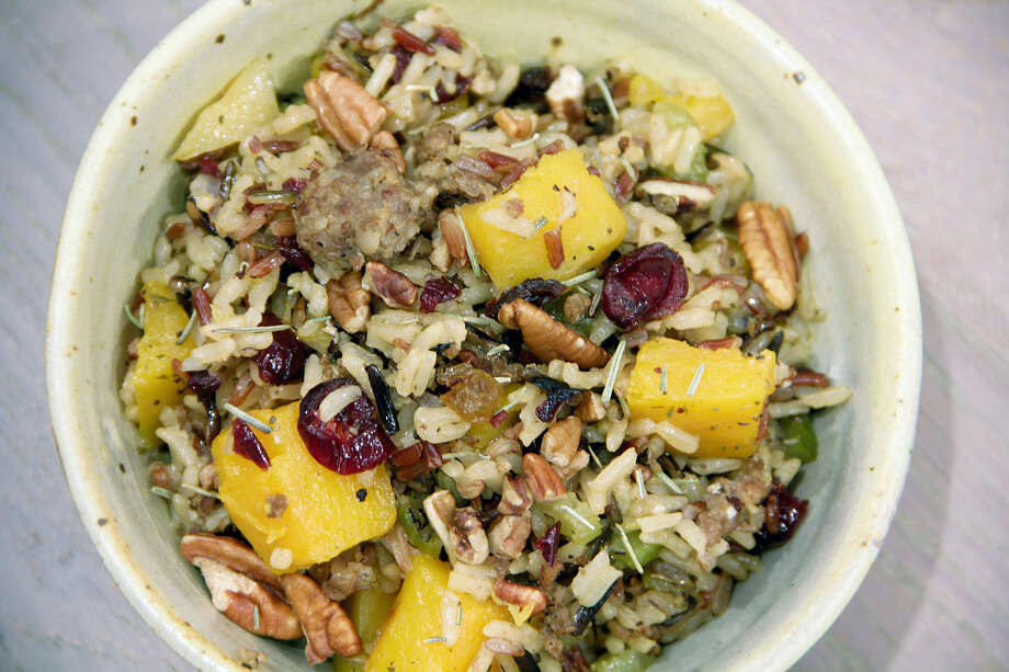 Wild rice stovetop dressing complements meat and fish dishes. Photo: Melissa D'Arabian — The Associated Press   / Melissa d'Arabian