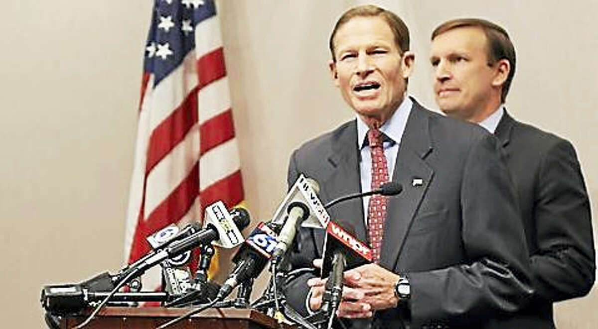 U.S. Sens. Richard Blumenthal and Chris Murphy speak with reporters at the Legislative Office Building in Hartford on Monday.