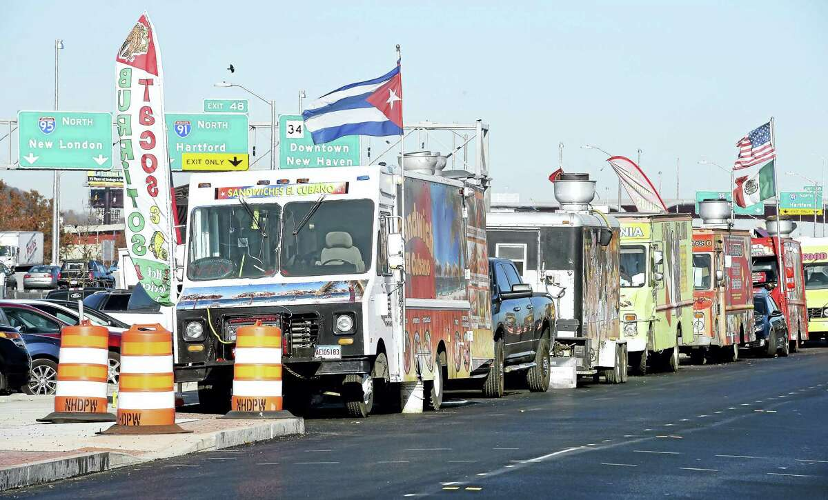 Food trucks line Long Wharf Drive during lunchtime in New Haven Monday.