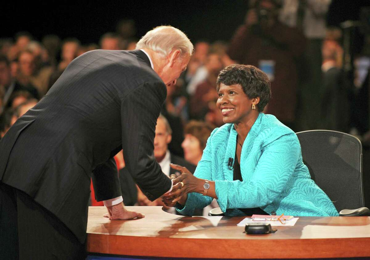 In this file photo, PBS journalist and debate moderator Gwen Ifill and then-Democratic vice presidential nominee, Sen. Joe Biden, D-Del., left, shake hands at the end of his vice presidential debate with Republican rival, Alaska Gov. Sarah Palin in St. Louis, Mo. Ifill died on Monday of cancer, PBS said. She was 61.