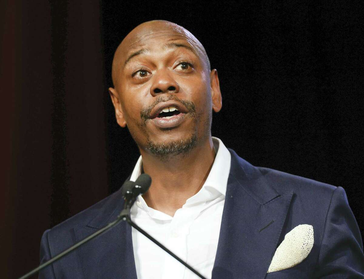 """In this July 18, 2015 file photo, comedian Dave Chappelle speaks at the RUSH Philanthropic Arts Foundation's Art for Life Benefit in New York. """"Saturday Night Live"""" called on host Chappelle's wit for a thoughtful coda to a divisive presidential campaign. Chappelle offered an African-American take onPresident-elect, Donald Trump's victory over Hillary Clinton, saying he hadn't seen white people so mad since the O.J. Simpson verdict."""
