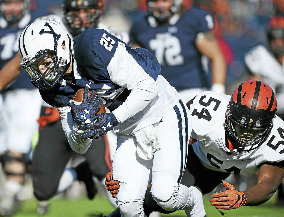 Princeton Rohan Hylton tackles Yale wide receiver Kyle Marcinick in the first half, Saturday, November 12, 2016, as the Tigers defeated the Bulldogs, 31-3, in their final home game of the season at the Yale Bowl. (Catherine Avalone/New Haven Register) Photo: Digital First Media / New Haven RegisterThe Middletown Press