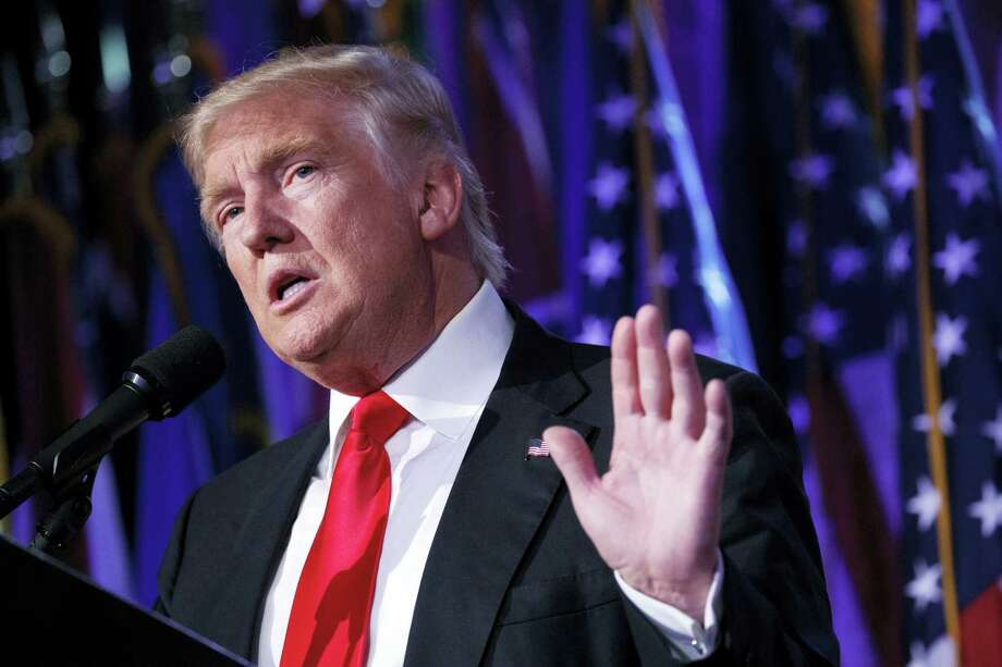 """President-elect Donald Trump speaks during a rally in New York. Trump elicited wild cheers on the campaign trail by pledging to """"drain the swamp"""" in Washington but the president-elect's transition team is populated largely with creatures of the capital, including former federal bureaucrats, think-tank academics, corporate lawyers and special interests lobbyists. Photo: Evan Vucci — AP Photo / Copyright 2016 The Associated Press. All rights reserved."""