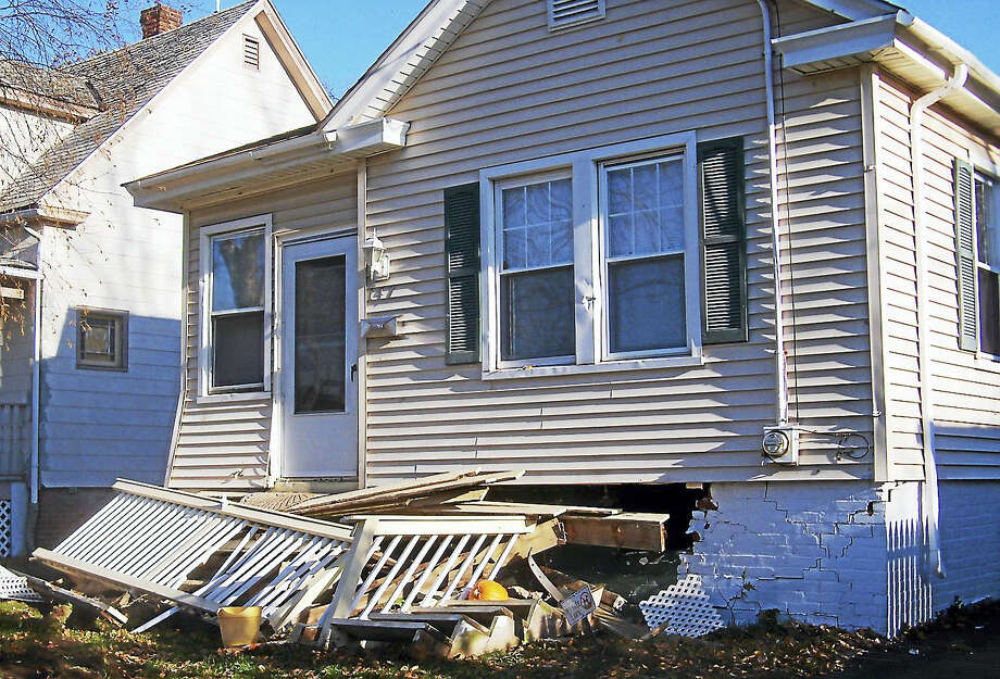 State police are searching for at least three suspects after a multi-car pursuit along the Shoreline early Friday. One of the vehicles crashed into a house at 147 Dodge Ave in East Haven. Photo: Wes Duplantier — New Haven Register