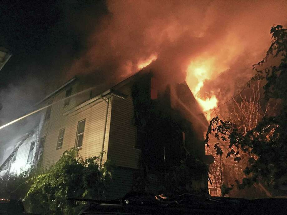 New Haven Fire DepartmentFirefighters battle a blaze at 18 Harding Place on Friday evening in New Haven. Photo: Digital First Media