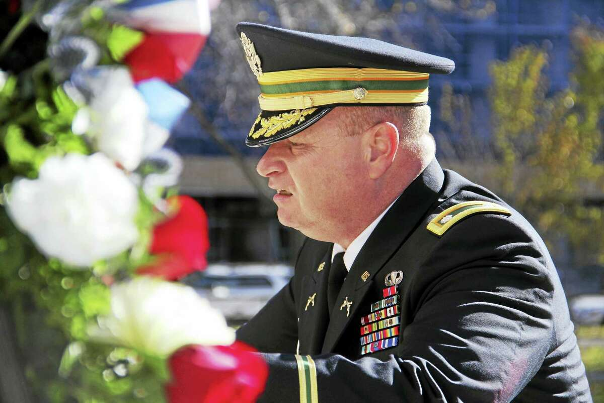 Connecticut Army National Guard Lt. Col. James H. McLean places a wreath on the city's World War Memorial on the Green in observance of Veterans Day.