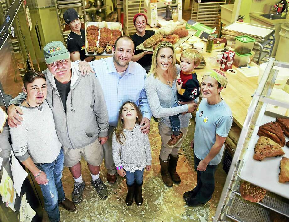 From left, Alex Malaspinas, manager of Scratch Baking; U.S. Marine Corps veteran John Antignano of New Haven; Joseph and Stephanie Scaretta of Trumbull with their children Kayli, 7, and Jackson, 2; and Scratch Baking owner/baker Lesli Flick. At rear are head baker Kate Donato, left, and baker Kiele Portelinha. Photo: Peter Hvizdak — New Haven Register   / ?2016 Peter Hvizdak