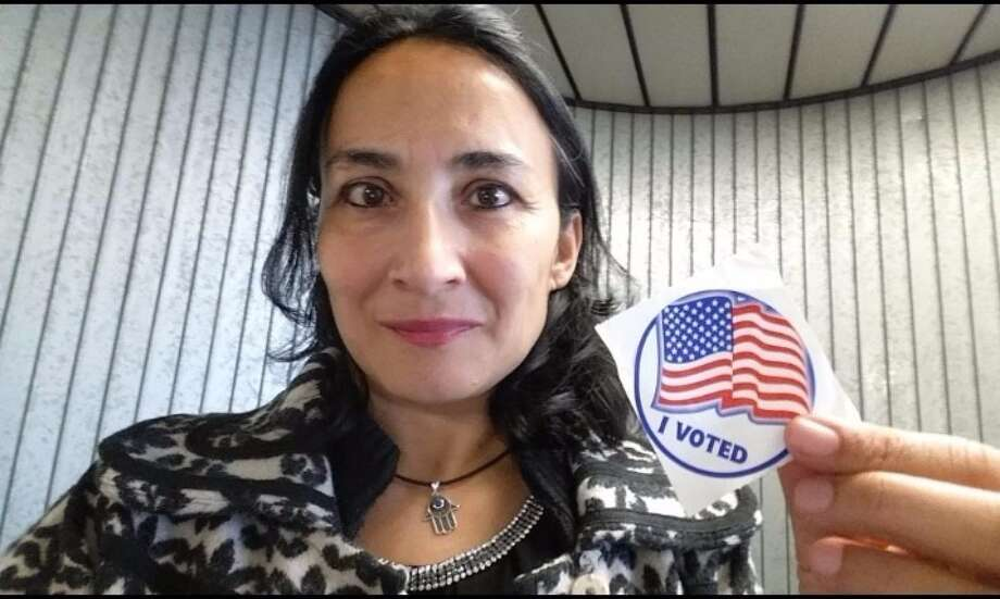"Asra Nomani poses after casting her ballot. ""I, a 51-year-old, a Muslim, an immigrant woman ""of color,"" am one of those silent voters for Donald Trump."" Photo: Photo Provided By Asra Nomani   / THE WASHINGTON POST"