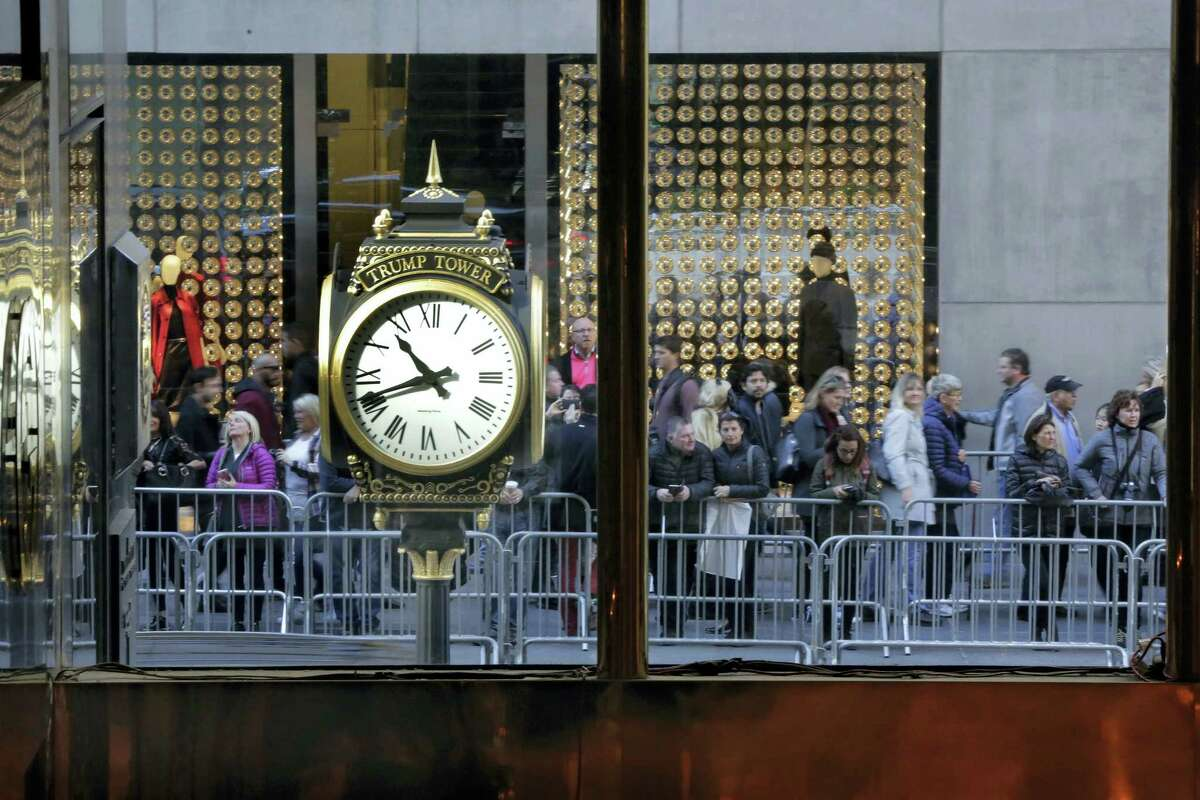 People stop to look at the front of Trump Tower on Fifth Avenue in New York Friday.
