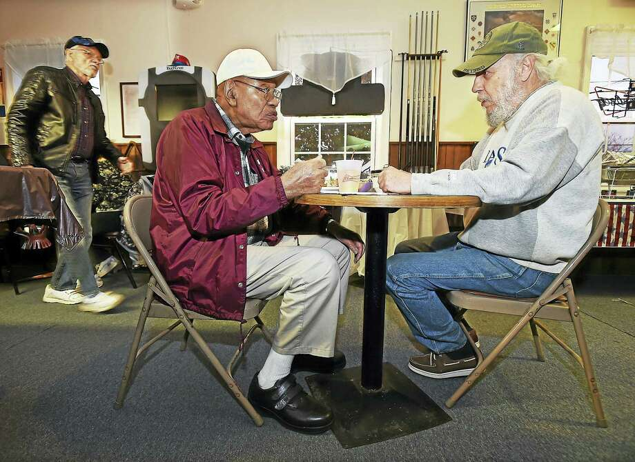 Veterans Charles Patterson, 86, left and Steve Fletcher, 67, both of Hamden, enjoy a free dinner at American Legion Post 88 on Veterans Day, courtesy of local businessman Zafar Farooqui. In the background is Hamden veteran Bob Schwarz, 74. Photo: Catherine Avalone — New Haven Register   / New Haven RegisterThe Middletown Press