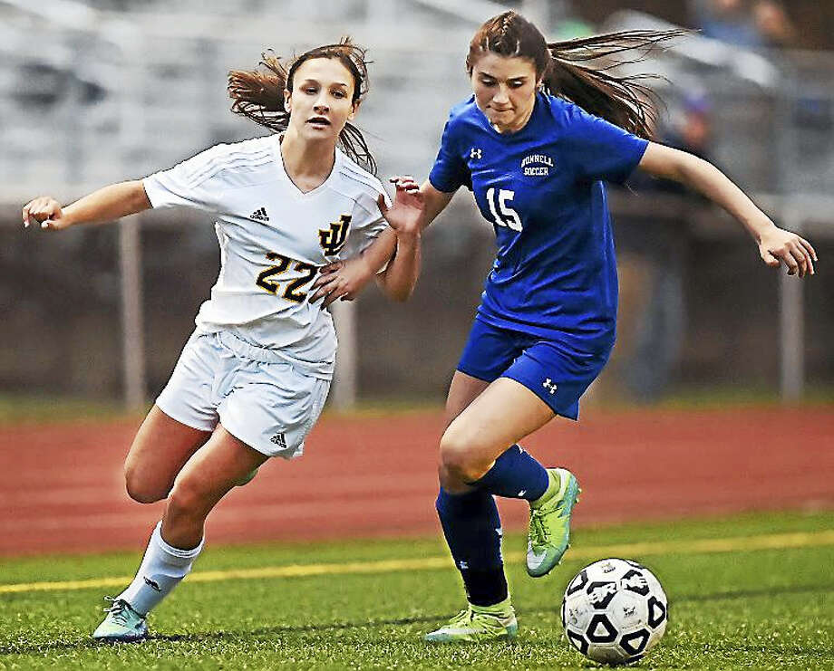 Law sophomore Jocelyn Wirth defends Bunnell sophomore Rebecca Romano resulting in a win for the Bulldogs in the class L first round in the CIAC girls state soccer tournament Wednesday, Nov. 9, 2016 at Jonathan Law High School in Milford. Photo: Catherine Avalone — New Haven Register