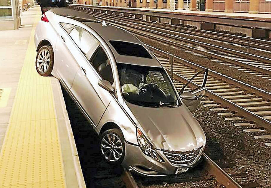 The train tracks at the West Haven Metro-North station were shut down for a short time early Thursday after a car crashed onto the tracks. The driver had suffered a medical emergency, police said. Photo: Photo Courtesy Of The West Haven Police Department