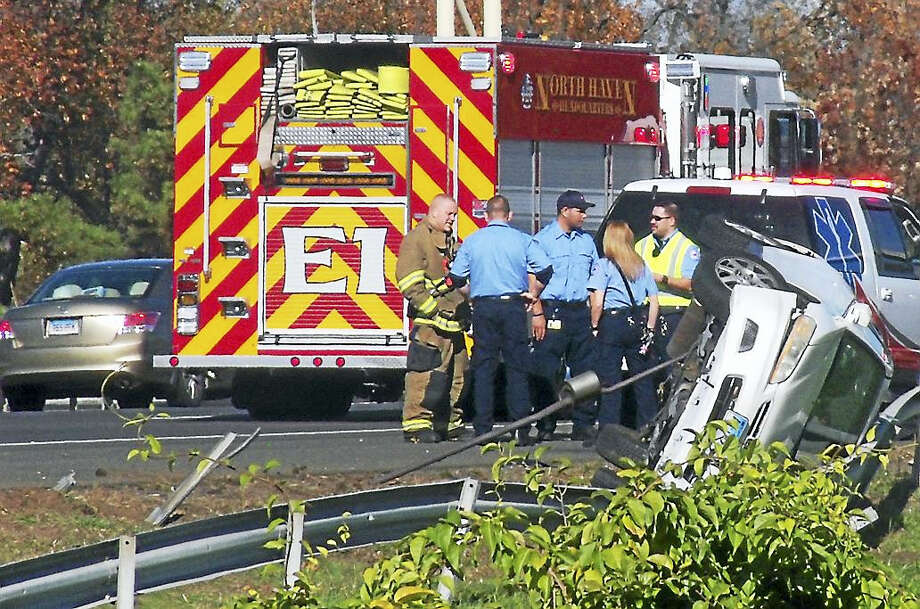 Two lanes of Interstate 91 northbound were blocked near the New Haven-North Haven line after a vehicle rolled over and crashed against a guardrail. Two people were evaluated for injuries. Photo: (Wes Duplantier/The New Haven Register)
