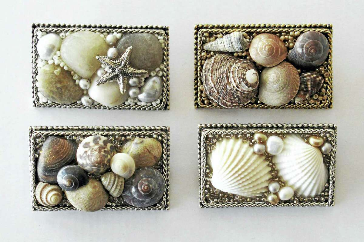 Jackie McGuire's work of beach stones, shells, freshwater pearl and silver.
