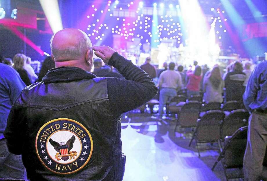"A veteran salutes during last year's ""Vets Rock"" concert. Photo: Photo Courtesy Of Mohegan Sun"