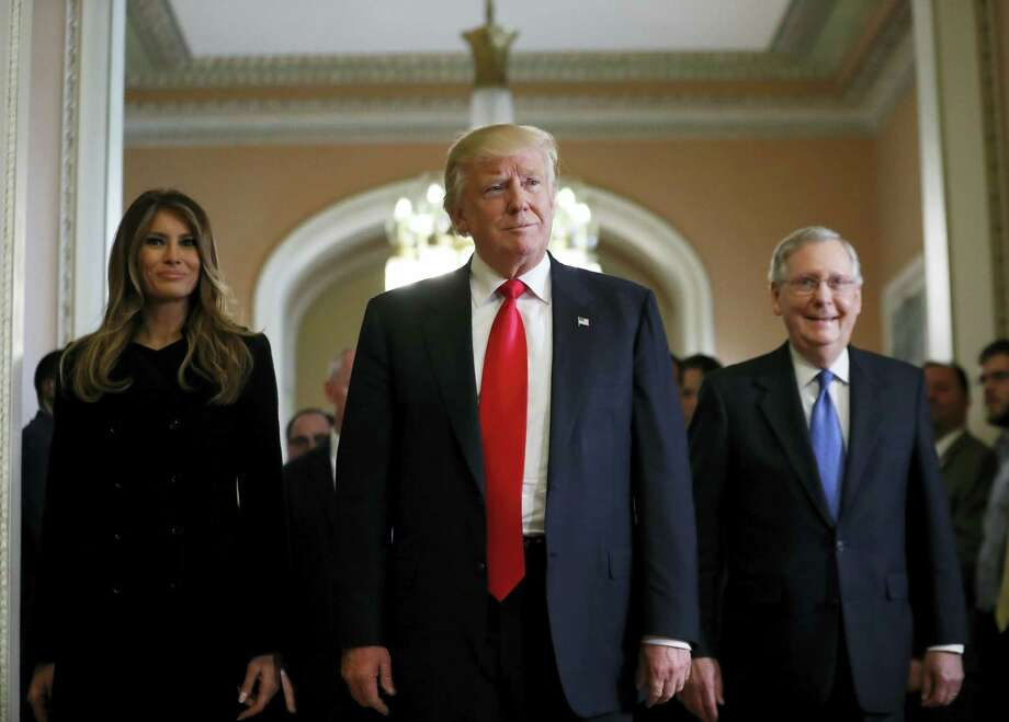 President-elect Donald Trump and his wife Melania walk with Senate Majority Leader Mitch McConnell of Ky. on Capitol Hill Thursday after a meeting. Photo: The Associated Press   / Copyright 2016 The Associated Press. All rights reserved.