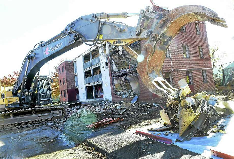 Demolition to the last remaining housing units on Olson Drive took place Thursday to make way for future home of Ansonia police station and new housing. Photo: Peter Hvizdak — New Haven Register   / ?2016 Peter Hvizdak