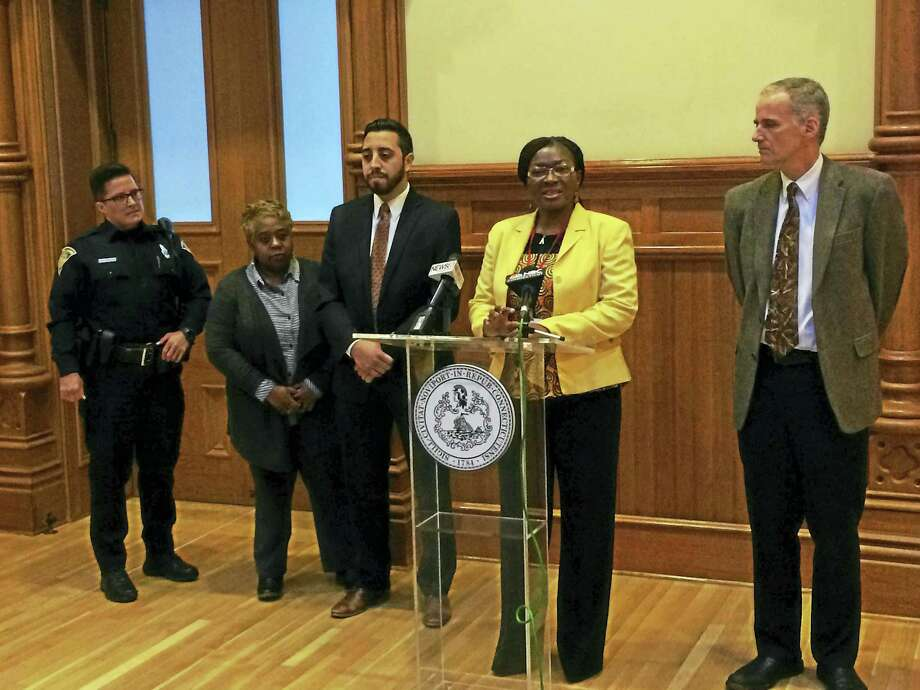 From right, John Bradley, executive director of Liberty Community Services; Martha Okafor, New Haven's community services administrator; Nicolas Phillips, representing Alexion Pharmaceuticals; Velma George, the city's director of homeless services; and New Haven police Officer Katherine Bisson. Photo: Contributed Photo